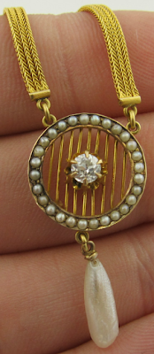 Edwardian woven 18k gold, seed pearl, and diamond lavalier.
