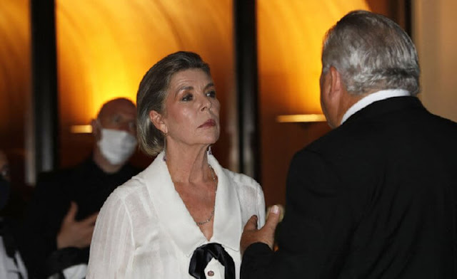 Princess Caroline of Hanover wore a floral print pleated skirt and white silk blouse from Chanel