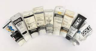 Black,white,gold,silver and irridescent paint.