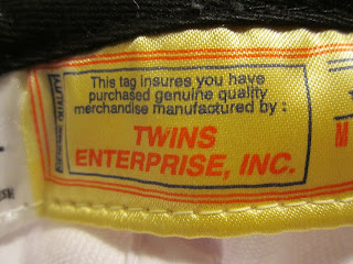 Twins Enterprise ball cap label
