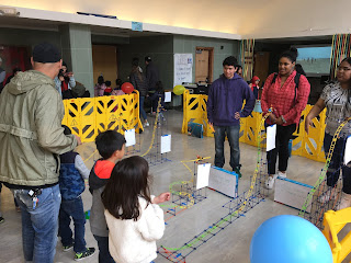 High school and preschool students participate in a roller coaster event to support making math fun