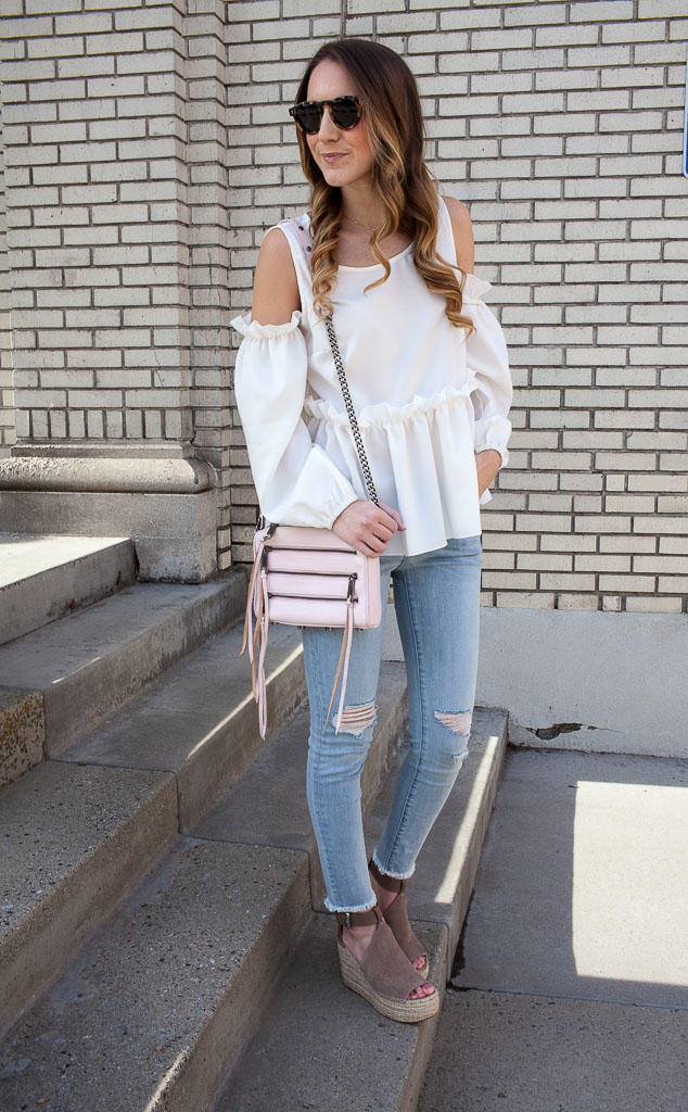 Ruffle cold shoulder top and distressed denim