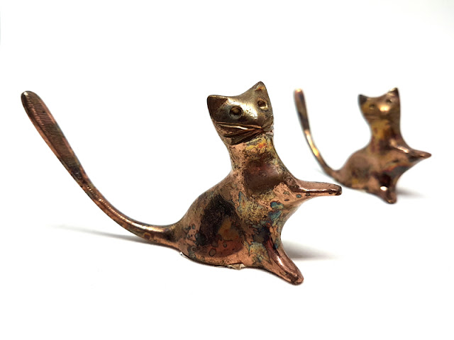 Companion Animal Psychology celebrates 7 years of blogging about pets and science. Photo shows two copper cat sculptures.