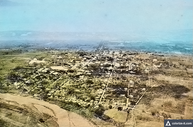Aerial photograph of Batangas City taken circa 1923.  Image source:  United States National Archives.  Colorized by Algorithmia.