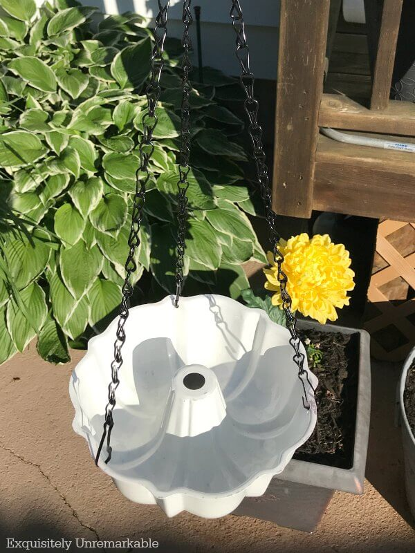 Bundt pan on chain hanging in garden