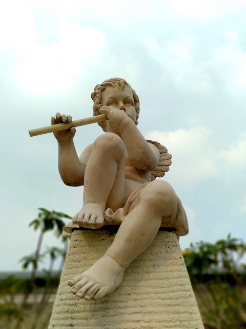 A Little Angel Playing Flute Statue - Bogor