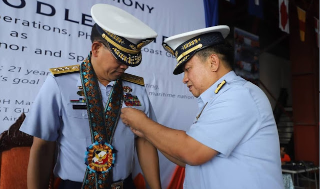 Personalized rosette lei being given to Philippine Coast Guard official