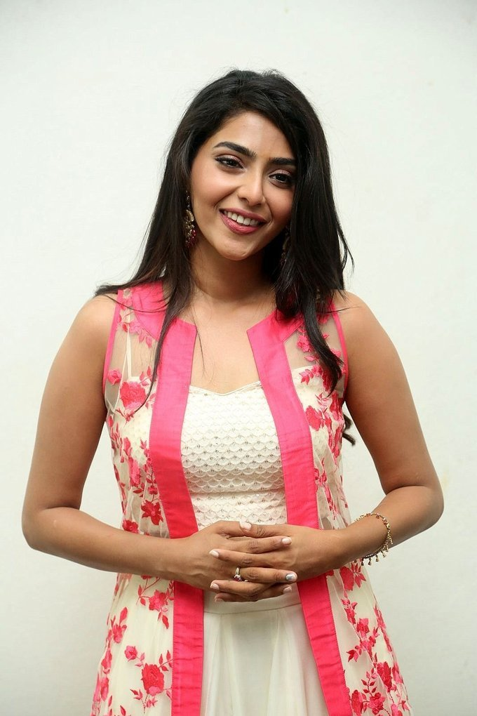 Aishwarya Lakshmi In White Dress At New Telugu Movie Launch