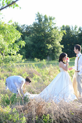 wedding coordinator fixing dress