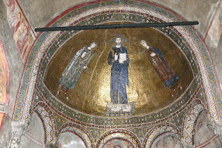 A mosaic inside Trieste's cathedral depicts Christ with the Saints Justus and Severus to either side of him