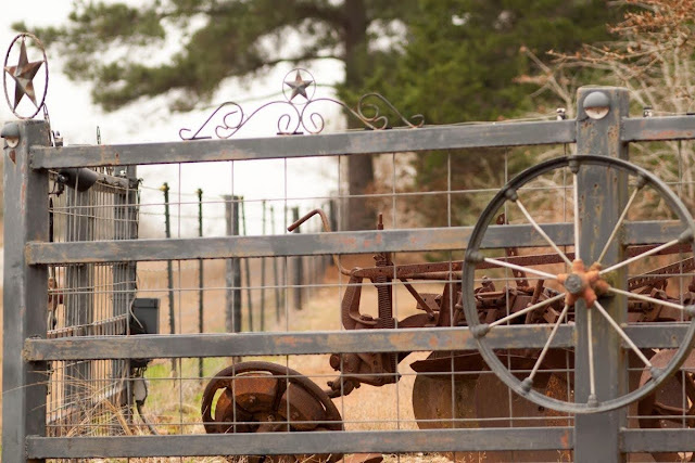 Farm equipment and a lone star on an Austin to Houston drive in Texas