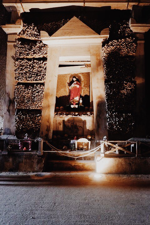 Shrine of long bones with Jesus at Cimitero Delle Fontanelle