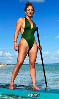 singer,- actress -,dancer- green -swimsuit- snap- makes- millions- like