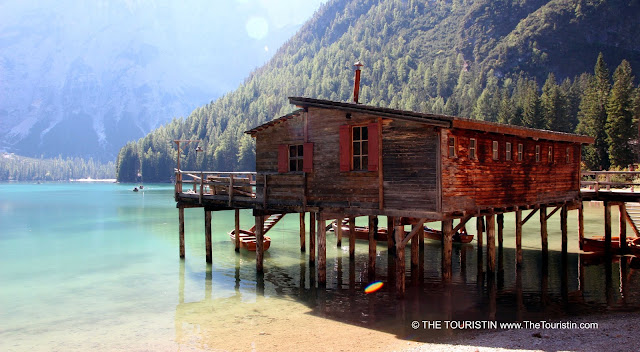 Wooden hut and boats with a view over the lake at Lago di Braies in the UNESCO nature heritage listed Prags Dolomites