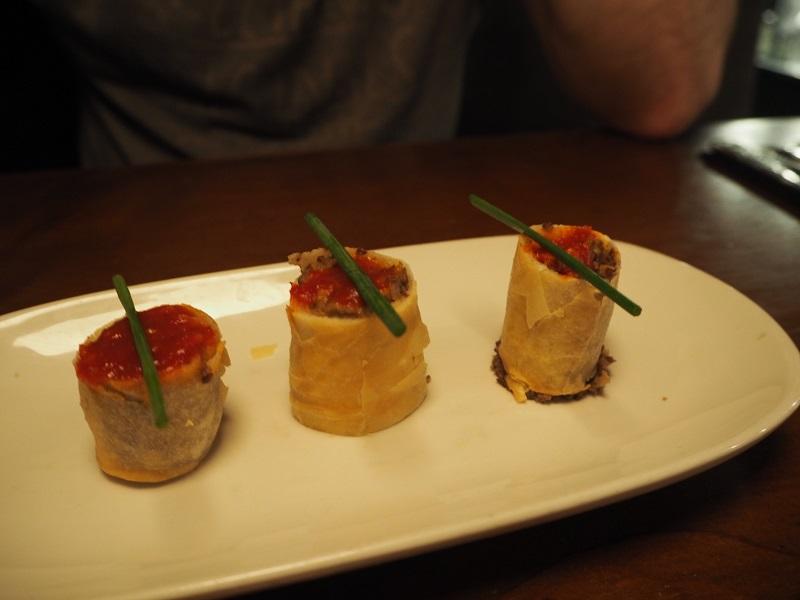 Haggis spring rolls with het sass