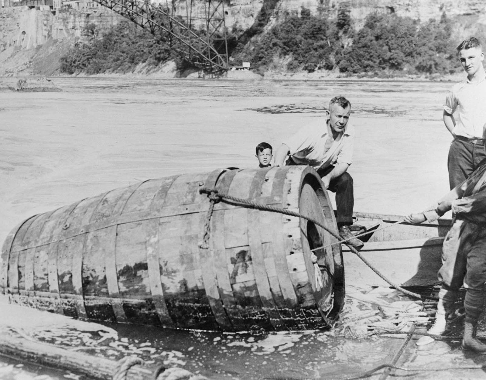 The body of George Stathakis is recovered from his one-ton barrel after going over the falls and becoming trapped for more than 18 hours. 1930.