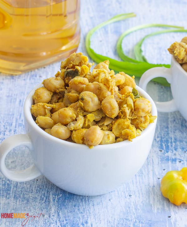 A close up of curried chicpeas in a cup