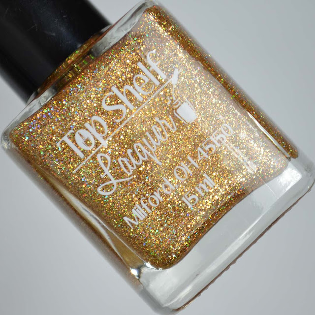 holo gold nail polish in a bottle
