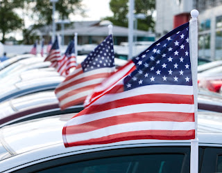 American flags on dealership cars