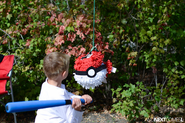 Breaking a paper mache pokeball pinata at a Pokemon themed birthday party
