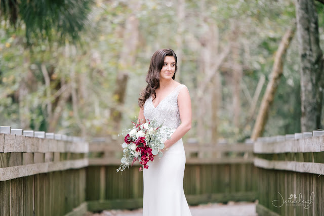 bride in wedding dress and red bouquet