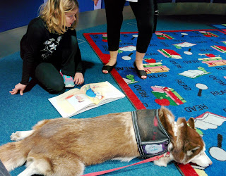 Therapy Dog helping kids with their reading
