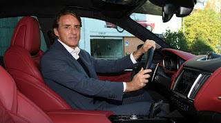 Silvia Fortini's husband Roberto sitting inside the car