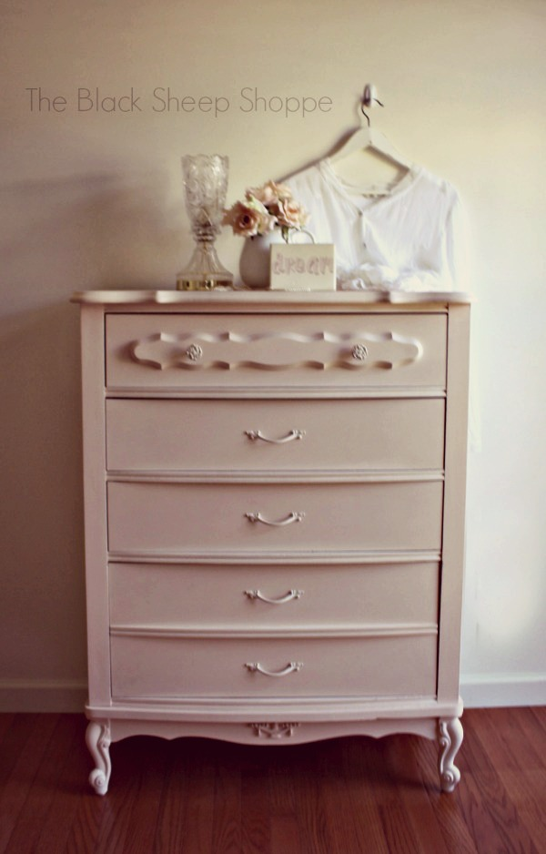 Romantic vintage dresser painted in a soft pink.