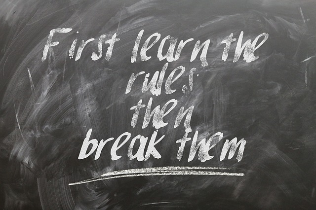'First learn the rules then break them' written on a chalk board