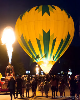 Cramer Imaging's fine art photograph of a hot air balloon glow and a candle-lighting at night in Panguitch Utah