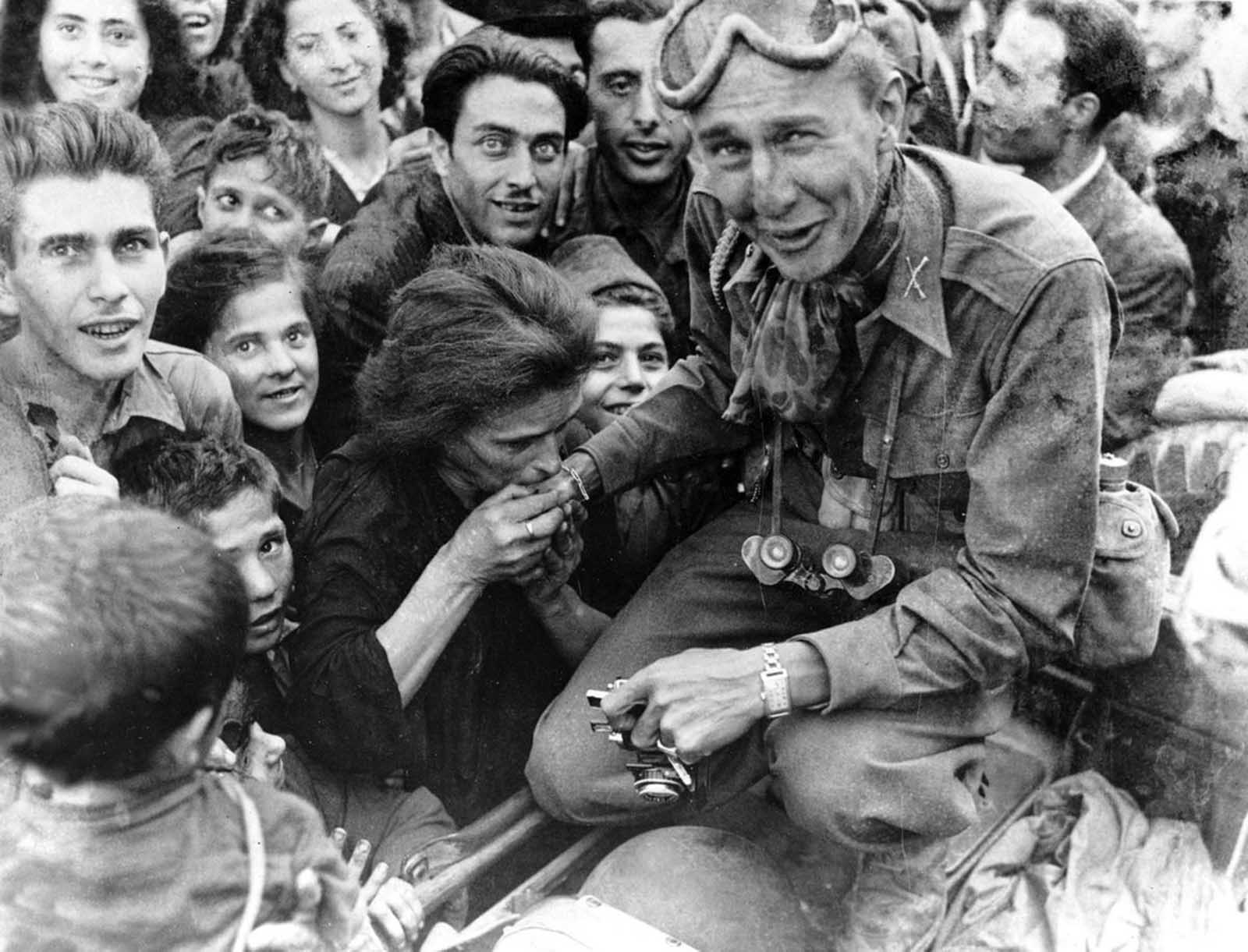 An Italian woman kisses the hand of a soldier of the U.S. Fifth Army after troops move into Naples in their invasion and advance northward in Italy, on October 10, 1943.