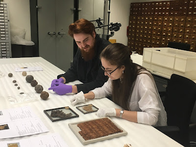 Max and Abi looking at Egyptian rush matting from the Archaeology collection