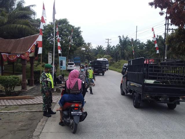 Ops PPKM Level lV Dalam Pos Pam Operasi Aman Nusa II di Pos Perlanaan Dilakukan Personel Jajaran Kodim 0207/Simalungun