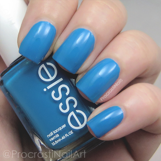 Swatch of the bright blue nail polish Essie Nama-Stay-the-Night