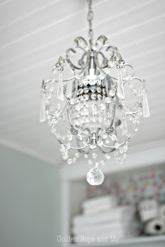 Chandelier from Overstock in master bathroom - www.goldenboysandme.com