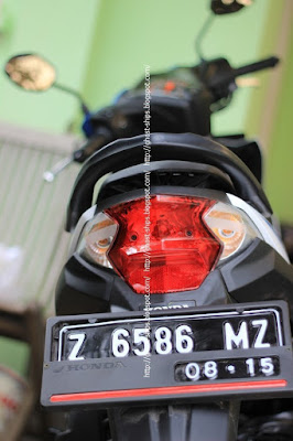 Ilustrasi sepeda motor Honda Beat.