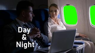 Airline passengers sitting beside green screen airplane windows. Free Download