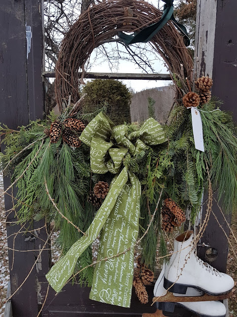 Grapevine wreaths with fresh evergreens and ribbon
