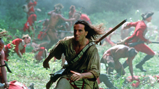 Daniel Day-Lewis running through a battlefield in The Last of the Mohicans