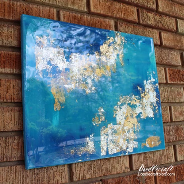 Abstract canvas art with gold, silver and varigated leaf, coated in high gloss resin.