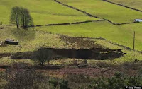 http://sciencythoughts.blogspot.co.uk/2013/12/fifty-meter-sinkhole-opens-up-in-peak.html