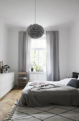 design minimalista della camera da letto principale