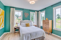 Nifty bright bedroom design ideas with teal walls and natural lights