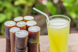 sugarcane with sugarcane juice in a glass