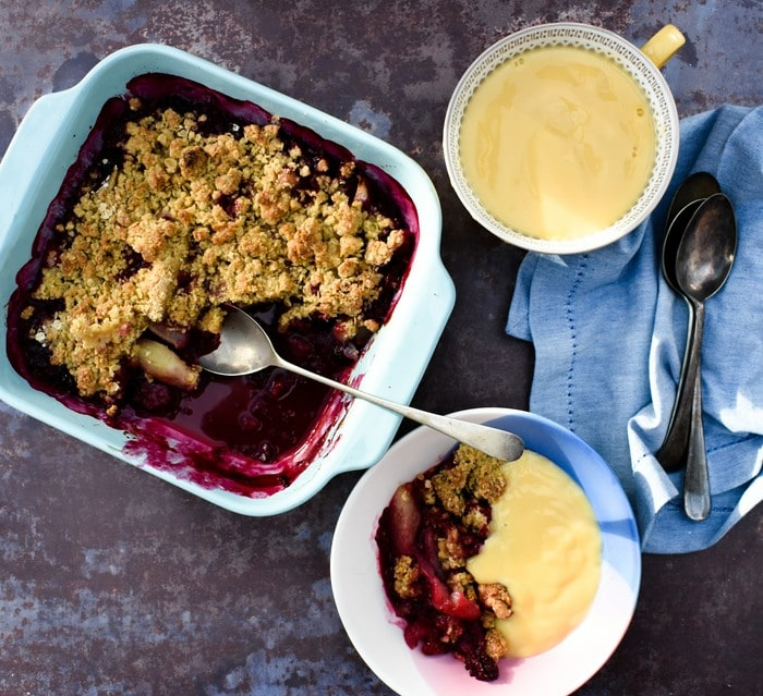 Scottish Blackberry & Pear Crumble served up in bowls with custard