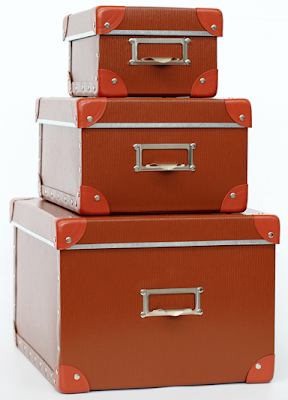 three orange storage boxes, stacked - small, medium and large
