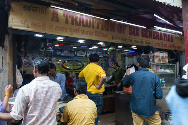 people eating in paratha wali gali eating places restaurant in Chandni Chowk area of Old Delhi India