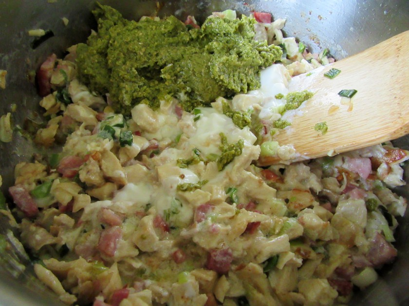 Stir in sour cream, pesto and grated cheese.