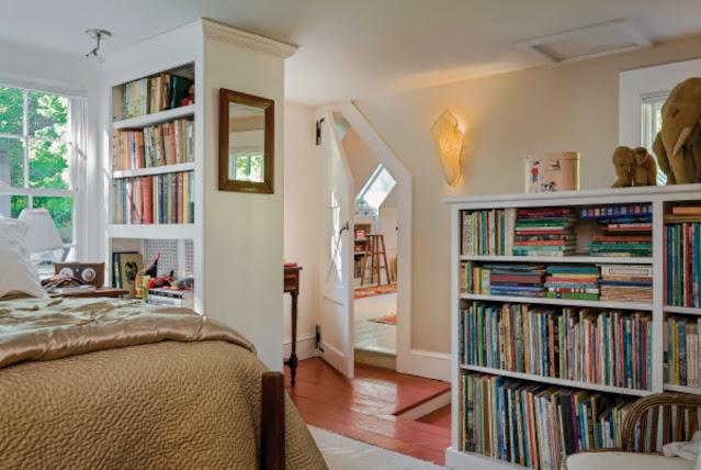 bookshelves in a guest bedroom