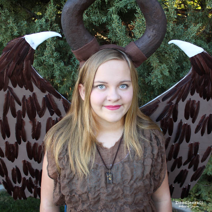 Young Maleficent costume cosplay diy with giant wings and sculpted horn headband handmade for Halloween. Based on the Disney Maleficent movie.
